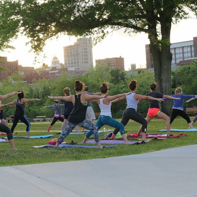 people in a yoga pose outdoors