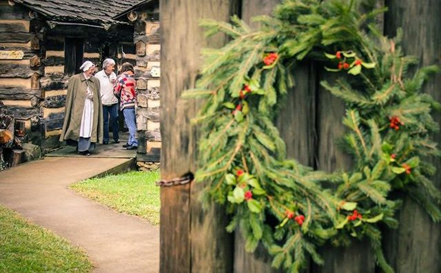 pine wreath on gate at fort