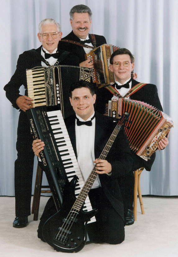 four members of a family polka band holding accordions
