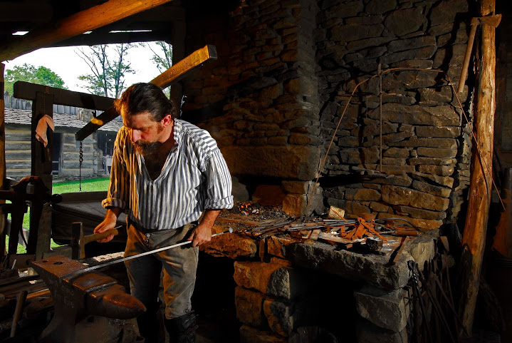 man dressed in frontier clothes portraying a blacksmith