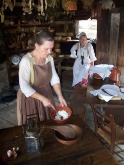 costumed interpreter demonstrating cooking