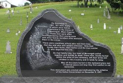 large black stone engraved with information about a mine disaster