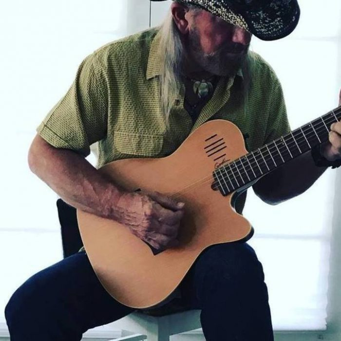 Greg Short playing guitar