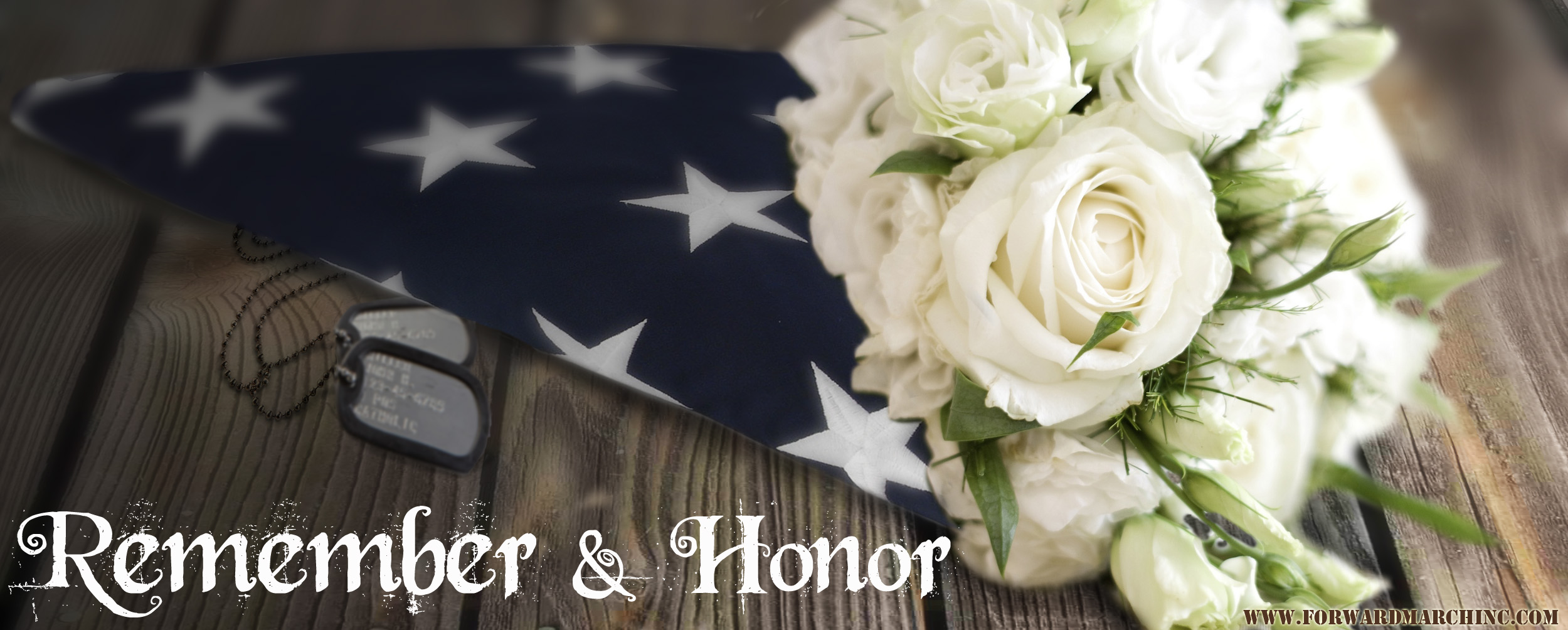 American flag with white roses beside it