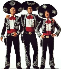 three men dressed in black Mexican-style hats, jackets and pants